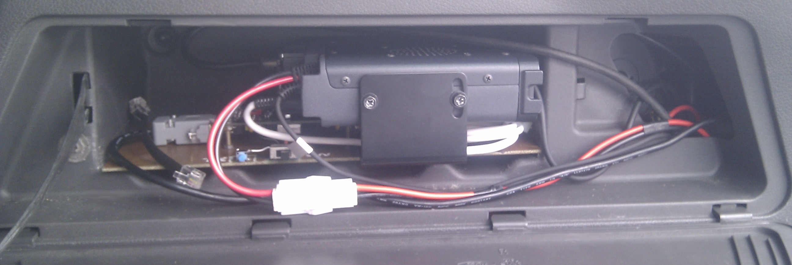 Radio and Tracker in car boot